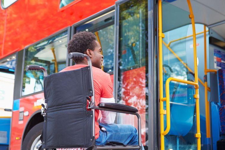 Person in wheelchair boarding a wheelchair accessible bus.